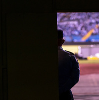 SAN PEDRO SULA, HONDURAS - SEPTEMBER 8: Security stands in the arena before a game between Honduras and USMNT at Estadio Olímpico Metropolitano on September 8, 2021 in San Pedro Sula, Honduras.