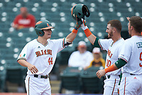 Michael Burns (44) of the Miami Hurricanes celebrates with Romy Gonzalez (10) and Carl Chester (9) after a home run against the Georgia Tech Yellow Jackets during game one of the 2017 ACC Baseball Championship at Louisville Slugger Field on May 23, 2017 in Louisville, Kentucky. The Hurricanes walked-off the Yellow Jackets 6-5 in 13 innings. (Brian Westerholt/Four Seam Images)