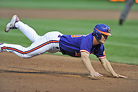 Clemson Tigers catcher Garrett Boulware #30 slides into third during a game against the Florida State Seminoles at Doug Kingsmore Stadium on March 22, 2014 in Clemson, South Carolina. The Seminoles defeated the Tigers 4-3. (Tony Farlow/Four Seam Images)