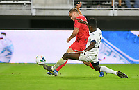 WASHINGTON, D.C. - OCTOBER 11: Jordan Morris #11 of the United States kicks a ball past Erick Rizo #3 of Cuba during a Nations League game between the USA and Cuba at Audi Field, on October 11, 2019 in Washington D.C.