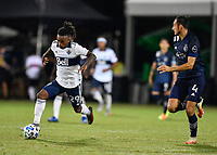 LAKE BUENA VISTA, FL - JULY 26: Yordy Reyna of Vancouver Whitecaps FC dribbles away from Roberto Puncec during a game between Vancouver Whitecaps and Sporting Kansas City at ESPN Wide World of Sports on July 26, 2020 in Lake Buena Vista, Florida.