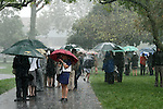 Downpouring rains plague the Keeneland paddock before the running of the Shadwell Turf Mile.   October 05, 2013.