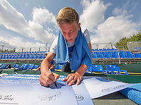 Moscow, Russia, 13 th July, 2016, Tennis,  Davis Cup Russia-Netherlands, Training Dutch team, Tim van Rijthoven signing autographes on posters i<br /> Photo: Henk Koster/tennisimages.com