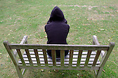 Teenage girl on a park bench (posed by model)