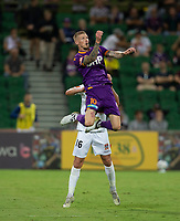 27th March 2021; HBF Park, Perth, Western Australia, Australia; A League Football, Perth Glory versus Newcastle Jets; Andy Keogh of Perth Glory jumps for the header against Matthew Millar of the Newcastle Jets