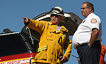 East Fork Fire & Paramedic District Fire Marshal Steve Eisele, left, and Fire Chief and Director of Douglas County Emergency Management Tod Carlini watch as crews rescue two swimmers Wednesday afternoon, July 20, 2011, off a 50-foot cliff near the Power Dam in Gardnerville, Nev. .Photo by Cathleen Allison