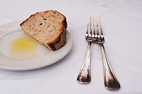 Warm bread and oil serve as an appetizer at a restaurant.