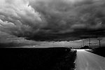 A storm appears over a cornfield near Le Claire, 2004