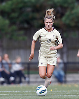 Boston College midfielder Kristen Mewis (19) on the attack. .After two overtime periods, Boston College (gold) tied University of Miami (orange), 0-0, at Newton Campus Field, October 21, 2012.