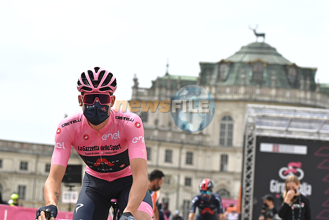 Race leader Maglia Rosa Filippo Ganna (ITA) Ineos Grenadiers at sign on before the start of Stage 2 of the 2021 Giro d'Italia, running 179km from Stupinigi (Nichelino) to Novara, Italy. 9th May 2021.  <br /> Picture: LaPresse/Marco Alpozzi | Cyclefile<br /> <br /> All photos usage must carry mandatory copyright credit (© Cyclefile | LaPresse/Marco Alpozzi)