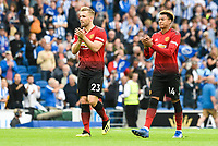 Luke Shaw of Manchester United (23) and Jesse Lingard of Manchester United (14)  after the Premier League match between Brighton and Hove Albion and Manchester United at the American Express Community Stadium, Brighton and Hove, England on 19 August 2018. Photo by Edward Thomas / PRiME Media Images.