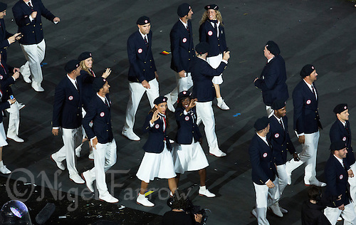 27 JUL 2012 - LONDON, GBR - Lolo Jones (USA) (centre front left) waves as she walks around the Olympic Stadium during the Opening Ceremony of the London 2012 Olympic Games in Stratford, London, Great Britain (PHOTO (C) 2012 NIGEL FARROW)