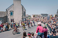 yellow jersey / GC leader Greg Van Avermaet (BEL/BMC) and teammates rolling through town, cathing up with the peloton just ahead and cheered on by huge crowds<br /> <br /> Stage 6: Brest > Mûr de Bretagne / Guerlédan (181km)<br /> <br /> 105th Tour de France 2018<br /> ©kramon
