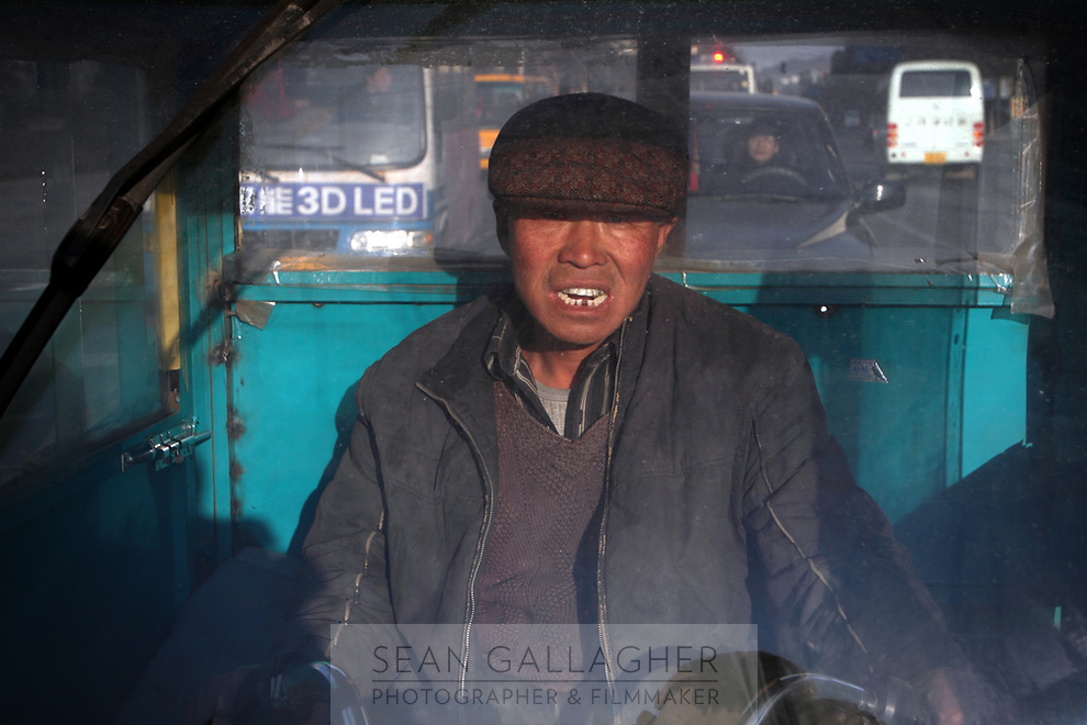 China. Jilin Province. A local resident in the town of Yanji, close to the border with North Korea. The town is part of the Korean Autonomous Prefecture in the north-east of the country. 2011