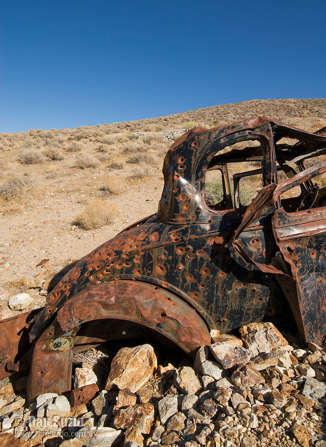 Remains of an abandoned car at Skidoo, a gold-mining boomtown in the Panamint Range on the west side of Death Valley. At its peak in 1907 the town had 700 residents. Death Valley National Park, California.