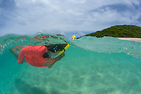 Snorkeler in the clear turquoise water surrounding Buck Island National Monument<br />