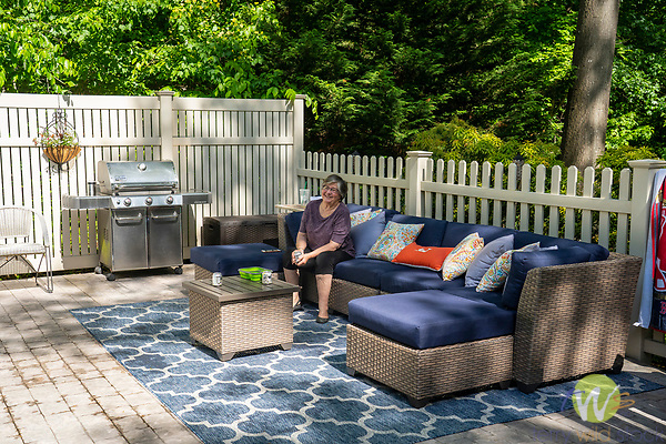 Duques poolside patio and furniture and grill.