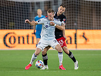 WASHINGTON, DC - MAY 13: Frederic Brillant #13 of D.C. United defends Robert Beric #27 of Chicago Fire FC during a game between Chicago Fire FC and D.C. United at Audi FIeld on May 13, 2021 in Washington, DC.