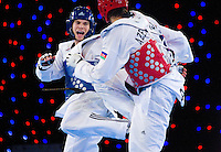 05 MAY 2012 - MANCHESTER, GBR - Aaron Cook (GBR) of Great Britain (left in blue) battles for points with Ramin Azizov (right in red) of Azerbaijan during the men's 2012 European Taekwondo Championships -80kg final at Sportcity in Manchester, Great Britain (PHOTO (C) 2012 NIGEL FARROW)