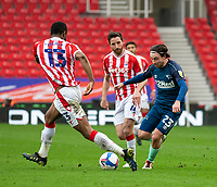 20th March 2021; Bet365 Stadium, Stoke, Staffordshire, England; English Football League Championship Football, Stoke City versus Derby County; Patrick Roberts of Derby County under pressure from John Obi Mikel of Stoke City