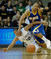 University of Delaware guard Jawan Carter, right, scrambles for a loose ball against Villanova University guard Corey Fisher, left, in the first half NCAA college basketball game Wednesday, Dec. 23, 2009 in Villanopva, PA. (AP Photo/Bradley C Bower)