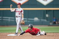 Arkansas Razorbacks shortstop Casey Martin (15) signals out as Texas Tech baserunner Brian Klein (5) holds onto the base during Game 5 of the NCAA College World Series on June 17, 2019 at TD Ameritrade Park in Omaha, Nebraska. Texas Tech defeated Arkansas 5-4. (Andrew Woolley/Four Seam Images)