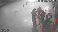 BNPS.co.uk (01202) 558833. <br /> Video: BNPS<br /> <br /> With Video - NEW Download Link: https://we.tl/t-jFBHCA9sRz<br /> <br /> Pictured: The attacker, circled, is seen inhaling from a balloon as he walks out of the camera shot. <br /> <br /> This is the shocking moment a thug viciously swings a lethal machete at a young man in the centre of Britain's most popular tourist resort that is packed with holidaymakers.<br /> <br /> The assailant produces the 18ins blade from out of his rucksack, holds it above his head and then swings it at his rival.<br /> <br /> It was only because the victim was agile enough to dodge out of the way of the weapon that he wasn't struck by it.<br /> <br /> CCTV footage shows him then run away while pursued by a pack of eight would be attackers in Bournemouth.