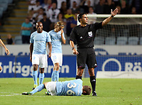 Thursday 08 August 2013<br /> Pictured:  Match referee Serdar Gozubuyuk calls physios to see to injured Petar Petrovic of Malmo<br /> Re: Malmo FF v Swansea City FC, UEFA Europa League 3rd Qualifying Round, Second Leg, at the Swedbank Stadium, Malmo, Sweden.