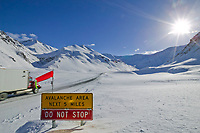 Avalanche sign at the base of Atigun Pass, the highest roadway pass in Alaska, along the James Dalton Highway (Haul Road) in the Brooks Range. The Haul Road provides access to the prudhoe bay oil fields.