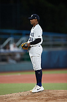 Hudson Valley Renegades starting pitcher Jhony Brito (34) looks to his catcher for the sign against the Wilmington Blue Rocks at Dutchess Stadium on July 27, 2021 in Wappingers Falls, New York. (Brian Westerholt/Four Seam Images)