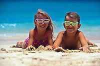 Kids with sunglasses playing on the beach in Hawaii