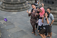 Borobudur, Java, Indonesia.  Indonesians Using their Tablet to Photograph Themselves.