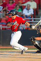 Cody Podraza #7 of the Hickory Crawdads follows through on his swing against the Greensboro Grasshoppers at  L.P. Frans Stadium July 10, 2010, in Hickory, North Carolina.  Photo by Brian Westerholt / Four Seam Images