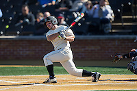 Joey Rodriguez (8) of the Wake Forest Demon Deacons follows through on his swing against the Richmond Spiders at David F. Couch Ballpark on March 6, 2016 in Winston-Salem, North Carolina.  The Demon Deacons defeated the Spiders 17-4.  (Brian Westerholt/Four Seam Images)