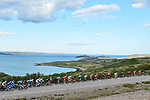 The peloton pass stunning scenery during Stage 1 of the 2018 Artic Race of Norway, running 184km from Vadso to Kirkenes, Norway. 16th August 2018. <br /> <br /> Picture: ASO/Gautier Demouveaux | Cyclefile<br /> All photos usage must carry mandatory copyright credit (© Cyclefile | ASO/Gautier Demouveaux)