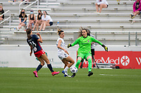 CARY, NC - APRIL 10: Cari Roccaro #21 of the NC Courage watches as Katelyn Rowland #0 of the NC Courage clears the ball from an on-rushing Ashley Hatch #33 of the Washington Spirit during a game between Washington Spirit and North Carolina Courage at Sahlen's Stadium at WakeMed Soccer Park on April 10, 2021 in Cary, North Carolina.