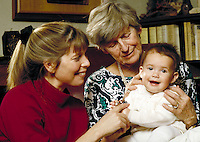 Grandmother and mother playing with baby at home #2. Family. Douglaston NY.