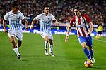 Atletico de Madrid's player Filipe Luis and Malaga CF Roberto Jose Rosales and Ignacio Camacho during a match of La Liga Santander at Vicente Calderon Stadium in Madrid. October 29, Spain. 2016. (ALTERPHOTOS/BorjaB.Hojas)