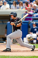 Brian Blasik (17) of the Quad Cities River Bandits follows through on his swing against the West Michigan Whitecaps at Fifth Third Ballpark on May 5, 2013 in Comstock Park, Michigan.  The River Bandits defeated the Whitecaps 5-4.  (Brian Westerholt/Four Seam Images)