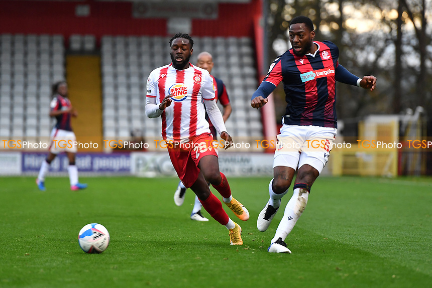 Aramide Oteh of Stevenage FC and Ricardo Santos of Bolton Wanderers F.C. during Stevenage vs Bolton Wanderers, Sky Bet EFL League 2 Football at the Lamex Stadium on 21st November 2020