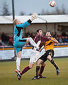 Stenny's Ross McMillan holds off Alloa's Martin Grehan as Stenny keeper Callum Reidford collects the ball.