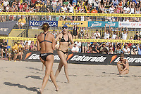 Huntington Beach, CA - 5/6/07:  Misty May-Treanor and Kerri Walsh celebrate after scoring during May-Treanor / Walsh's 21-13, 21-13 win over Branagh / Youngs in the championship match of the AVP Cuervo Gold Crown Huntington Beach Open of the 2007 AVP Crocs Tour..Photo by Carlos Delgado