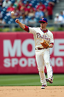Philadelphia Phillies second baseman Mike Fontenot #18 throws to first during the Major League Baseball game against the Pittsburgh Pirates on June 28, 2012 at Citizens Bank Park in Philadelphia, Pennsylvania. The Pirates defeated the Phillies 5-4. (Andrew Woolley/Four Seam Images).