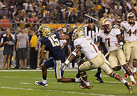 Pitt wide receiver Devin Street (15) tries to avoid a tackle from Florida State safety Tyler Hunter (1). Florida State defeated Pitt 41-13 at Heinz Field on September 2, 2013.