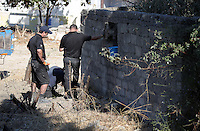 FAO JANET TOMLINSON, DAILY MAIL PICTURE DESK<br /> Pictured: Special forensics police officers search the area next to a disused building in a field in Kos, Greece. Saturday 01 October 2016<br /> Re: Police teams led by South Yorkshire Police, searching for missing toddler Ben Needham on the Greek island of Kos have moved to a new area in the field they are searching.<br /> Ben, from Sheffield, was 21 months old when he disappeared on 24 July 1991 during a family holiday.<br /> Digging has begun at a new site after a fresh line of inquiry suggested he could have been crushed by a digger.