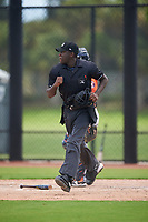 Umpire Jaylen Goodman during a Gulf Coast League game between the GCL Astros and GCL Nationals on August 9, 2019 at FITTEAM Ballpark of the Palm Beaches training complex in Palm Beach, Florida.  GCL Nationals defeated the GCL Astros 8-2.  (Mike Janes/Four Seam Images)