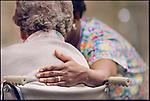 Nurse assisting senior woman on wheelchair at hospital