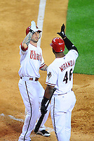 Apr. 26, 2011; Phoenix, AZ, USA; Arizona Diamondbacks third baseman Ryan Robert (left) is congratulated by Juan Miranda after hitting a solo home run in the sixth inning against the Philadelphia Phillies at Chase Field. Mandatory Credit: Mark J. Rebilas-