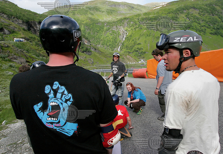 Post comptetion discussion about the runs down the mountain. The first ever Norwegian Longboarding Championship was held during the Extreme Sport Week, an annual event that draws adrenalin junkies to the small Norwegian mountain town of Voss. © Fredrik Naumann
