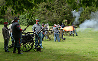 Members of the cannon demonstration crew for Prairie Grove Battlefield State Park, fire, from left, a mountain howitzer, a field cannon and a Parrott rifle Saturday, May 1, 2021, during an artillery demonstration at the park in Prairie Grove. The group is made up of members of the First Arkansas Mountain Artillery and the Seventh Arkansas Field Artillery historical re-enactment groups. Visit nwaonline.com/210502Daily/ for today's photo gallery. <br /> (NWA Democrat-Gazette/Andy Shupe)